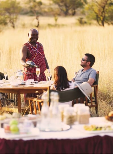 Couple enjoying breakfast in the African Bush during a family safari to Africa