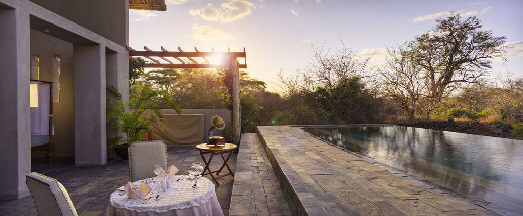 Private Dining setting overlooking the lush African bush at Finch Hattons Luxury Safari Campsite