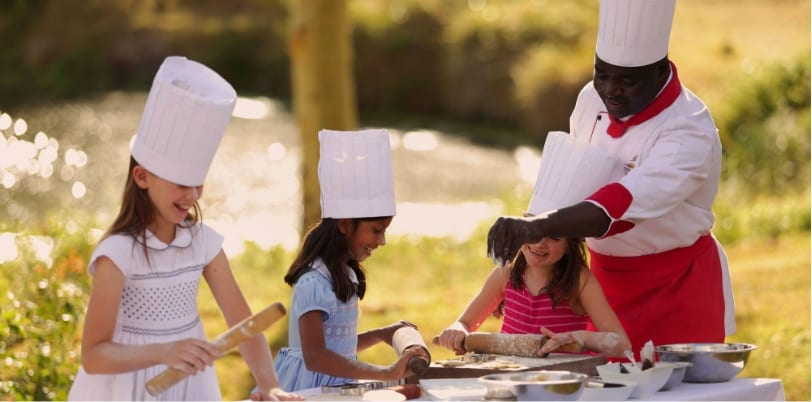 Children enjoying a cook-off while visiting Finch Hattons on a Family Safari Adventure