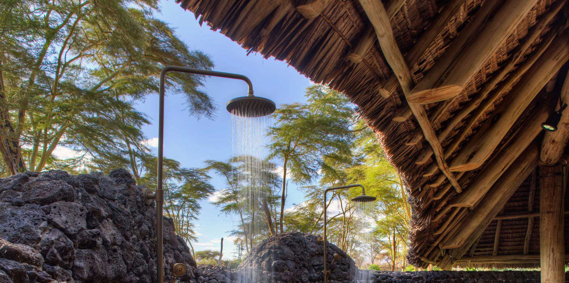 Outdoor showers at the luxury tent suites of Finch Hattons